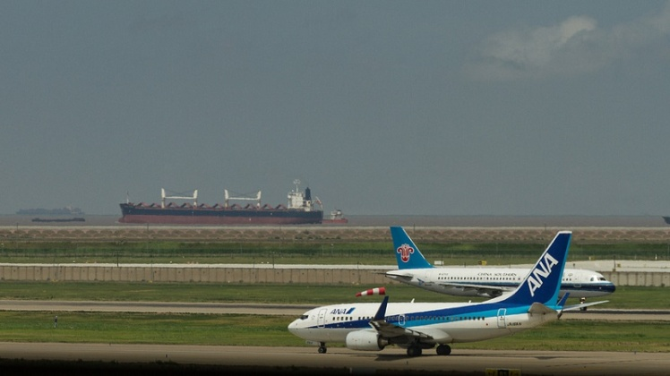 International transport emissions_ship-plane_Flickr.Phil.Norton